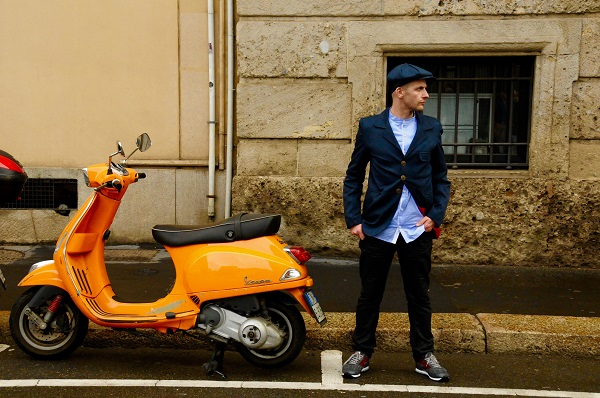 boy and a yellow vespa